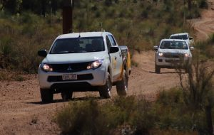 4WD's travelling on a sand track.