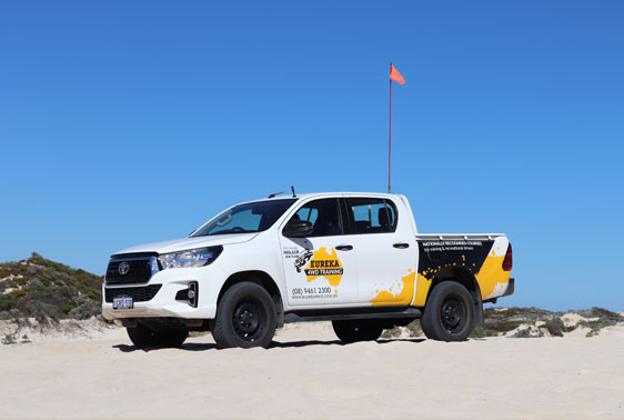 A 4WD parked on a sand terrain as the introductory 4wd course under recreational training.