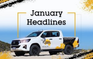 """A Eureka 4WD parked on a sand terrain with a header saying """"January Headlines""""."""