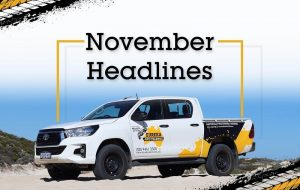 """A Eureka 4WD parked on a sand terrain with a header saying """"November Headlines""""."""
