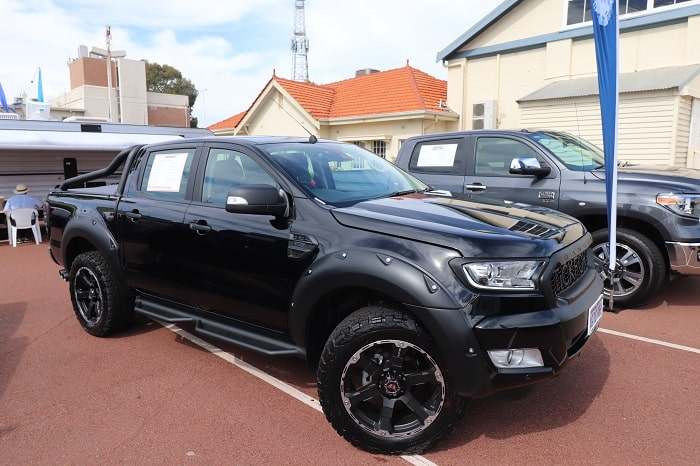 Black and gray 4wd parked as a participant of the 2019 caravan and camping show in Perth.