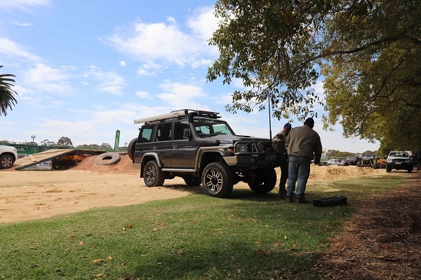 4wd on an off-road track doing the High Lift Jack recovery.