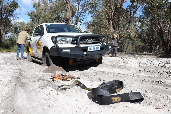 4wd on an off-road track doing the Snatch Strap recovery.