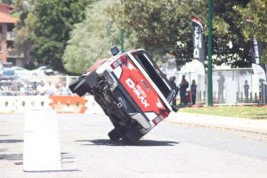 White and red coloured D-max doing tricks on a 4WD show.