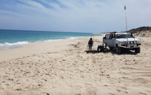 """White coloured 4WD parked on a beach and as the header of """"wilbinga conservation park"""" blog."""
