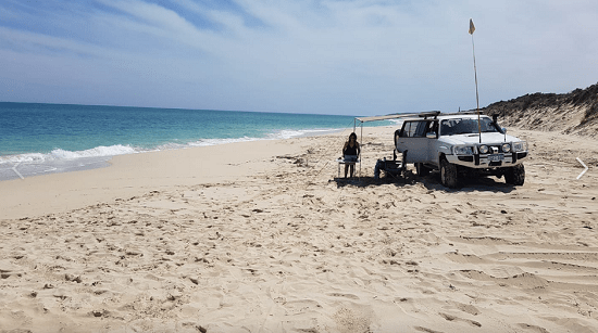 """White coloured 4WD parked on a beach that represents """"wilbinga conservation park"""" blog."""