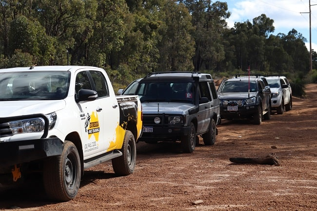Convoy 4wders travelling on an off-road track.