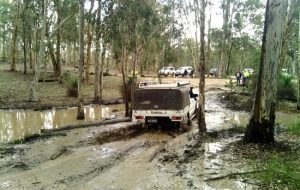 Toyota 4WD truck travelling on a muddy track.