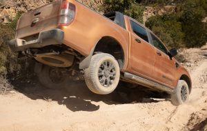 """""""Orange-brown 4WD on an off road track as the header of """"best 2019 dual-cab 4wd ute """""""" blog."""""""