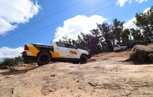 An official 4WD of Eureka 4WD parked on an off-road terrain.