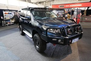 Black-coloured 4WD parked as a participant of the 2019 caravan/camping show in Perth.