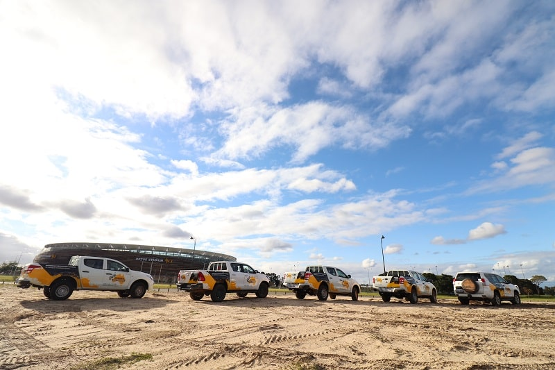 Eureka 4WD Training team parked in front of a stadium for a convoy travelling.